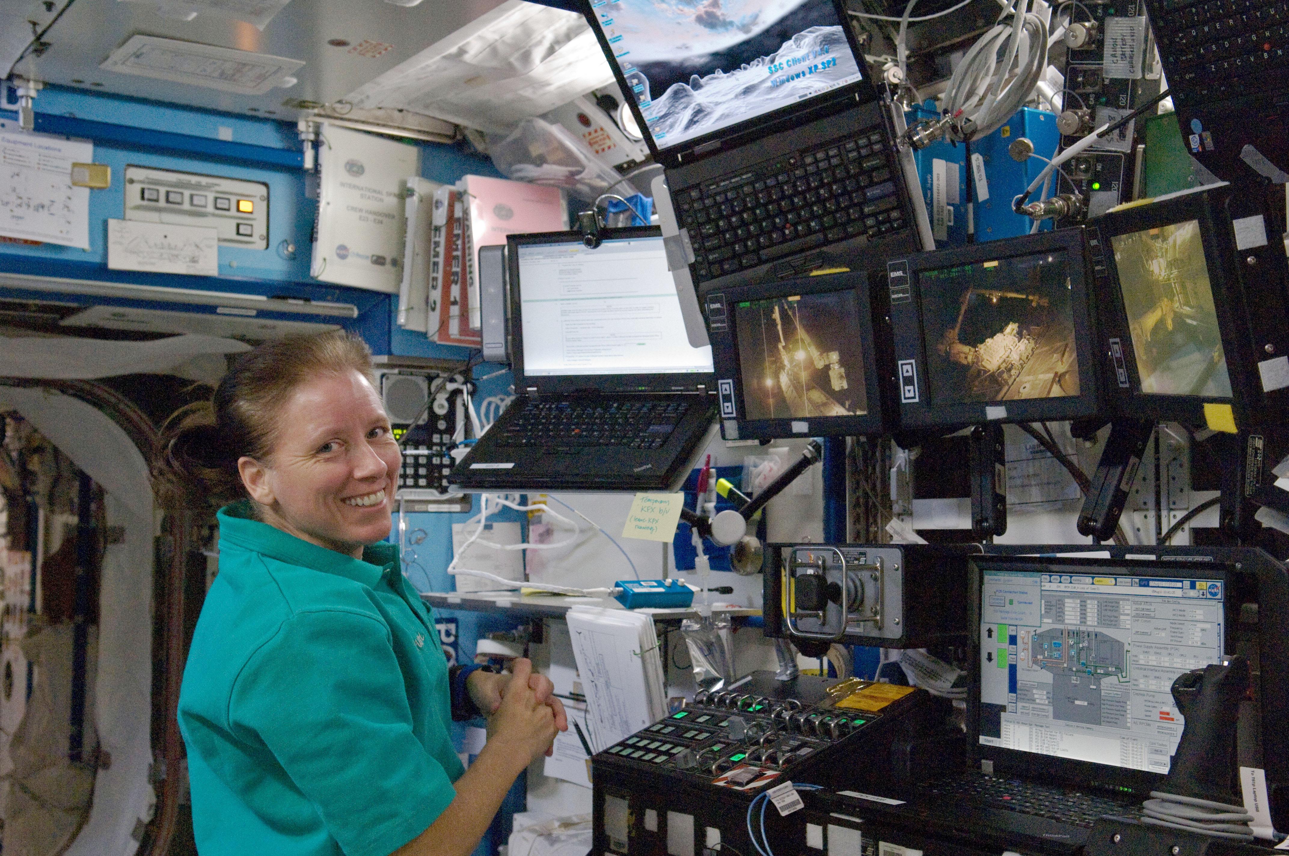 Shannon Walker in front of the robotic workstation.jpg