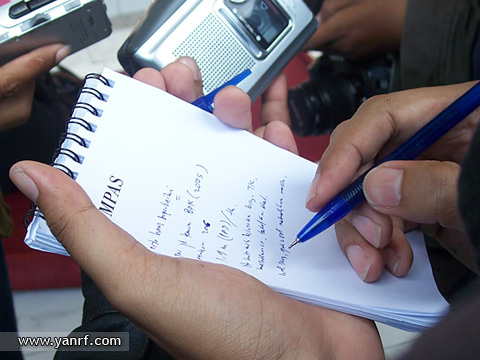 Journalists on duty by Yan Arief. Labeled for Reuse.